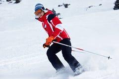 Ski woman turn on slope stock photo