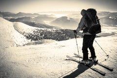 Skialpinist on snowy mountain Royalty Free Stock Image