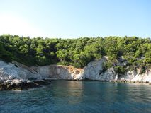 Island in the Aegean Sea. Skiathos became an important shipbuilding centre in the Aegean due to the abundance of pine forests on the island. The pine woods of royalty free stock photo