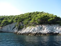 Island in the Aegean Sea. Skiathos became an important shipbuilding centre in the Aegean due to the abundance of pine forests on the island. The pine woods of royalty free stock images