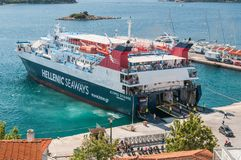 Skiathos, Greece. 15 June 2018: Helenic seaways ferry disembarks passengers and vehicles at Skiathos harbour. Skiathos, Greece. 15 June 2018: Helenic seaways royalty free stock photography