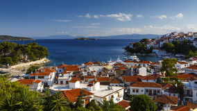 Skiathos island. View of the old harbour on Skiathos island and Euboea in the distance, Greece stock photo