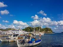 Skiathos old harbor fishing boats. Old fishing boats in skiathos old harbor port. Very windy awaiting the zorba hurricane. 26 september 2018 royalty free stock photography