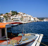 Skiathos port. Greece with fishing boat in foreground royalty free stock photos