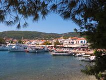 Skiathos Town, Aegean Greek Island, Boats Moored at Dock. Modern boats moored in Skiathos town, an Aegean Greek island, view from approaching ferry, with clear Stock Photos