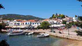 Skiathos Town, Aegean Greek Island, Boats Moored at Dock. Modern boats moored in Skiathos town, an Aegean Greek island, view from approaching ferry, with clear Stock Image