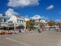 Skiathos town Greece. Tourists sitting at cafes and restaurants in skiathos old harbor town. 26 september 2018 royalty free stock photography