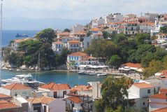 Skiathos town. On Skiathos Island, Greece. Beautiful view of the old town with boats in the harbor stock photo