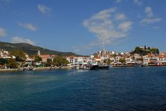 Skiathos town. On Skiathos Island, Greece. Beautiful view of the old town with boats in the harbor royalty free stock photos