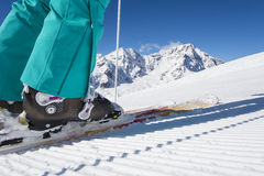 Skiboots in winterlandscape. Skiing boots with mountain background Stock Photos