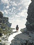 Skicklig ryttareridning ut ur öknen Arkivfoto