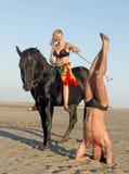 Skicklig ryttarinna och yogi Royaltyfria Bilder