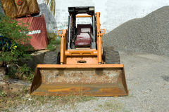 Skid loader. A skid loader in a building material depot Stock Photos