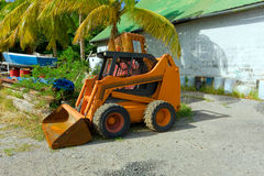 Skid loader. A skid loader in a building material depot Stock Photography