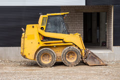 Skid loader on construction site Stock Photos