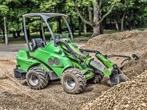 Skid loader with loaded gravel Royalty Free Stock Images