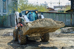 Skid loader on road construction Stock Image