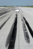 Skid marks on runway Stock Image