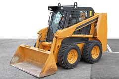 Skid Steer. Front Loader Machine at Construction Site stock photo