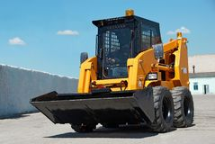 Skid steer loader construction. Machine with bucket outdoors Stock Image