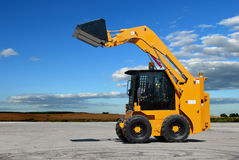 Skid steer loader construction. Machine with bucket outdoors Royalty Free Stock Photo
