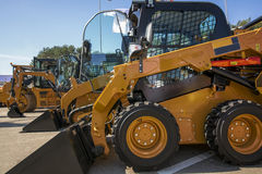 Skid steer loader. Construction machine with bucket outdoors Stock Photo