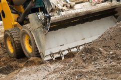 Skid steer loader works Stock Photography