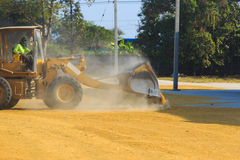 Skid steer loaders moving paddy Stock Photo