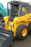 Skid Steer. Front Loader Machine at Construction Site royalty free stock photography