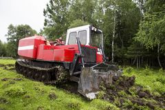 Skidding tractor in the work process Royalty Free Stock Photos