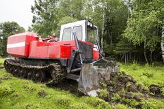 Skidding tractor in the work process Royalty Free Stock Photography