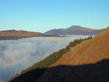 Skiddaw au-dessus de nuage Photographie stock libre de droits