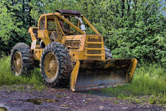 Skidder Rigged With A Snow Plow Stock Images