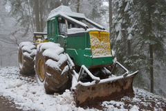 Skidder in the snow Royalty Free Stock Images