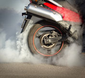 Skidding Motorcycle. Motorcycle tire burnout on the asphalt Stock Photography