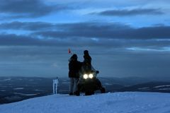 Skidoo. Cold day for wintersports. Ontop of the hill is a skidoo Stock Photography