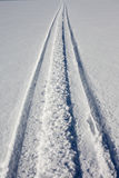Skidoo track in fresh clean snow Stock Photos