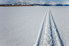 Skidoo track on frozen lake Stock Image