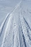 Skidoo track in the snow. Skidoo track crossing the snowy winter terrain stock photo