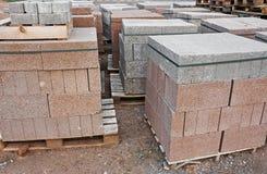 Skids of cinder blocks Stock Photo
