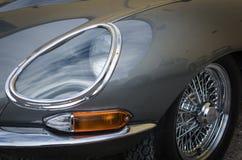 Headlight of a Silver Jaguar E veteran royalty free stock photos