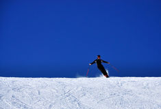 Skier. On the slope against blue sky Royalty Free Stock Photography