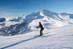 Skier. Coming fast on the slope. Motion blur Stock Photography