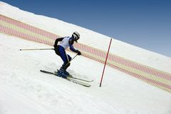 Skier. Young skier doing downhill slalom royalty free stock photography
