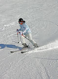 Skier. A skier stopping spraying snow into the air Stock Photography