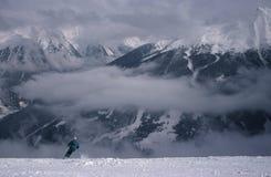 Skier. In backdrop of Badgastein, Austria Stock Photography