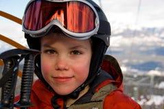 Skier. Boy riding ski gondola at Canadian resort Stock Photo