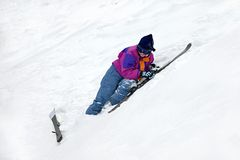 Skier. Beginner skier falling on the snow Royalty Free Stock Photography