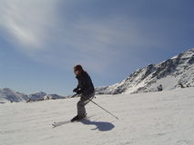 Skier. Woman skier on snow covered slopes Stock Photography