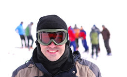 Skier. Portrait of a skier with his friends at downhill ski resort Royalty Free Stock Image